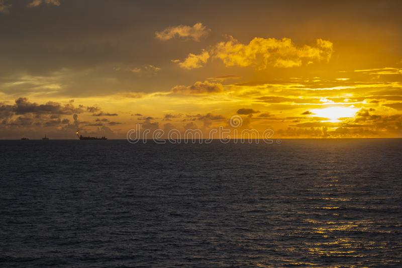 Area of work offshore on the high seas, the oil industry and a beautiful day and sunset, platform. Area of work offshore on the high seas, the oil industry and a stock images