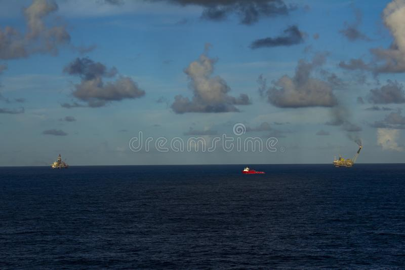 Area of work offshore on the high seas, the oil industry and a beautiful day and sunset, platform. Area of work offshore on the high seas, the oil industry and a royalty free stock photography