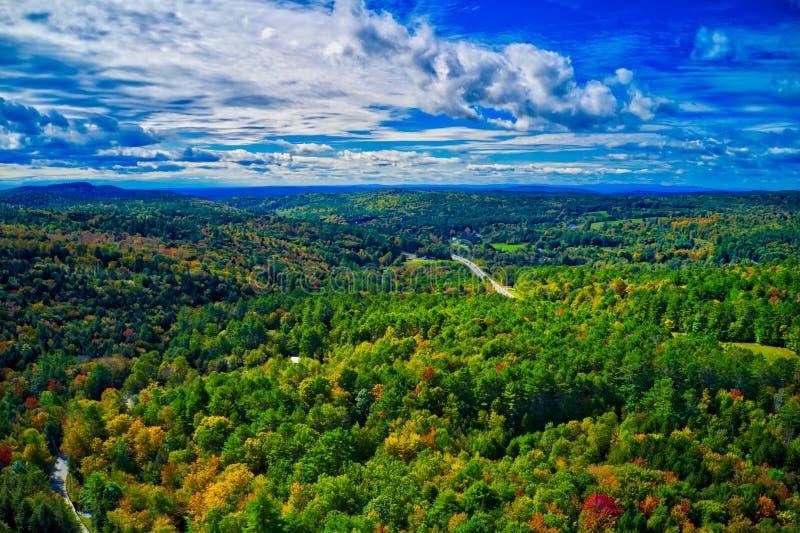 Areal Dramatic sky over new Hampshire fall foliage stock photos