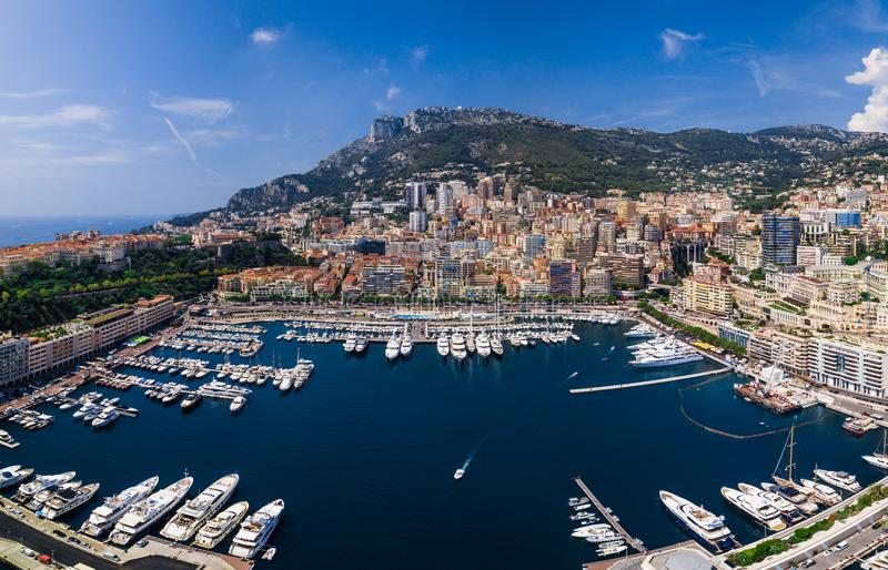 Areal view of the port in the rich city Monte-Carlo in Monaco. Areal view of the port in the rich city Monte-Carlo in Monaco,with the royal palace on the left royalty free stock image