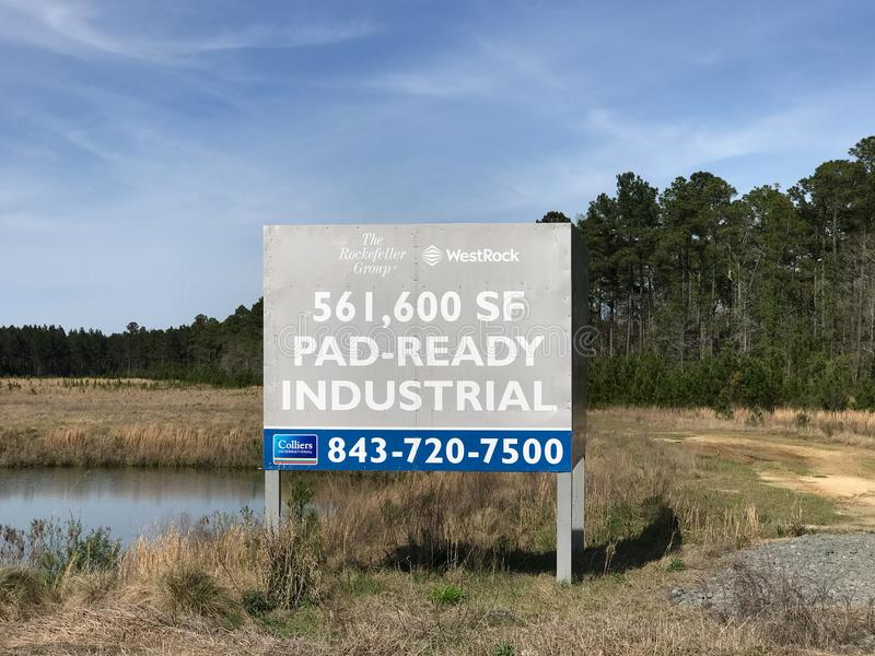 Commercial Real Estate For Sale Sign. Areas of the South East part of America are rapidly being developed, like this property with a commercial real estate sign royalty free stock photos