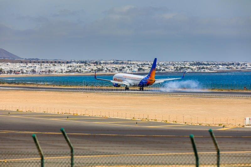 ARECIFE, SPAIN - APRIL, 15 2017: Boeing 737-800 of Jet2holidays. With the registration G-JZHA landing at Lanzarote Airport stock images