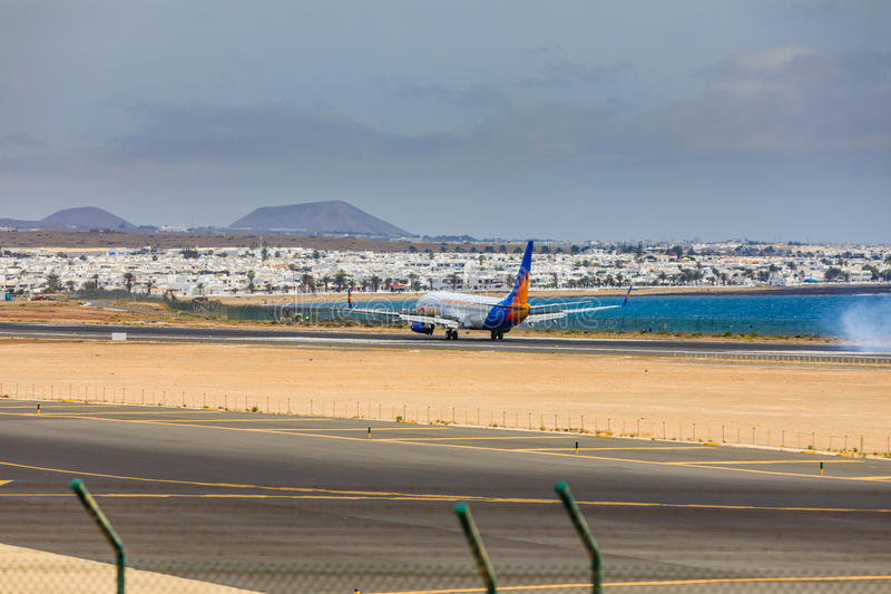 ARECIFE, SPAIN - APRIL, 15 2017: Boeing 737-800 of Jet2holidays. With the registration G-JZHA landing at Lanzarote Airport royalty free stock photos