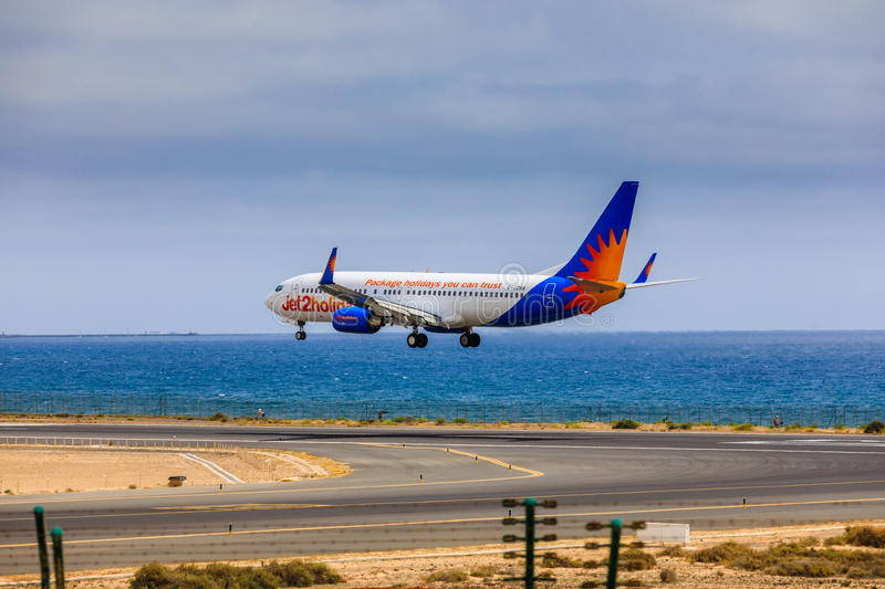 ARECIFE, SPAIN - APRIL, 15 2017: Boeing 737-800 of Jet2holidays. With the registration G-JZHA landing at Lanzarote Airport royalty free stock photography