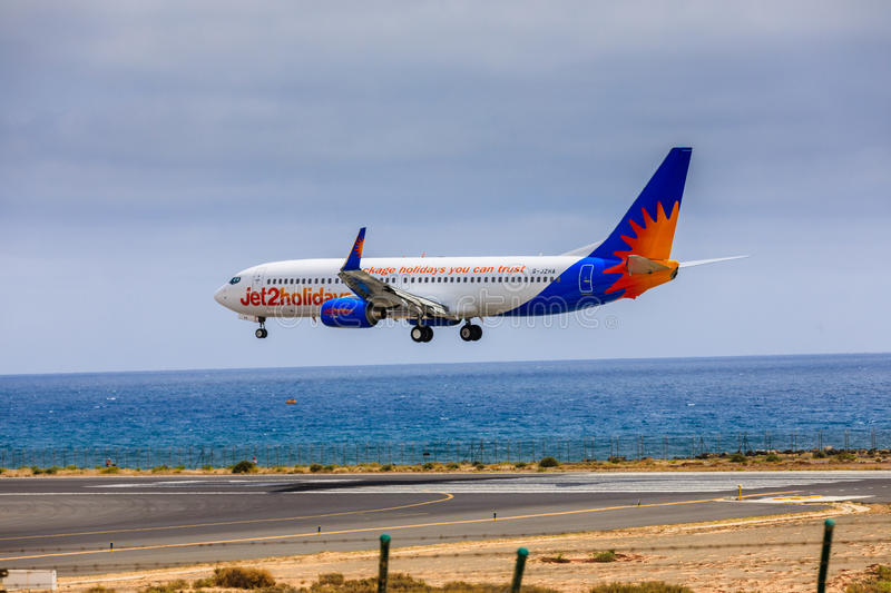 ARECIFE, SPAIN - APRIL, 15 2017: Boeing 737-800 of Jet2holidays. With the registration G-JZHA landing at Lanzarote Airport stock photos