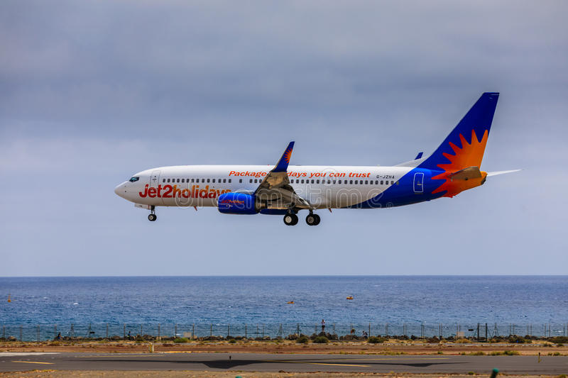 ARECIFE, SPAIN - APRIL, 15 2017: Boeing 737-800 of Jet2holidays. With the registration G-JZHA landing at Lanzarote Airport royalty free stock image
