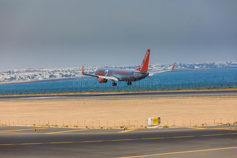 ARECIFE, SPAIN - APRIL, 16 2017: Boeing 737-800 of Jet2 with the. Registration G-Gdfx landing at Lanzarote Airport stock photography