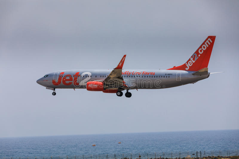 ARECIFE, SPAIN - APRIL, 16 2017: Boeing 737-800 of Jet2 with the. Registration G-Gdfx landing at Lanzarote Airport royalty free stock image