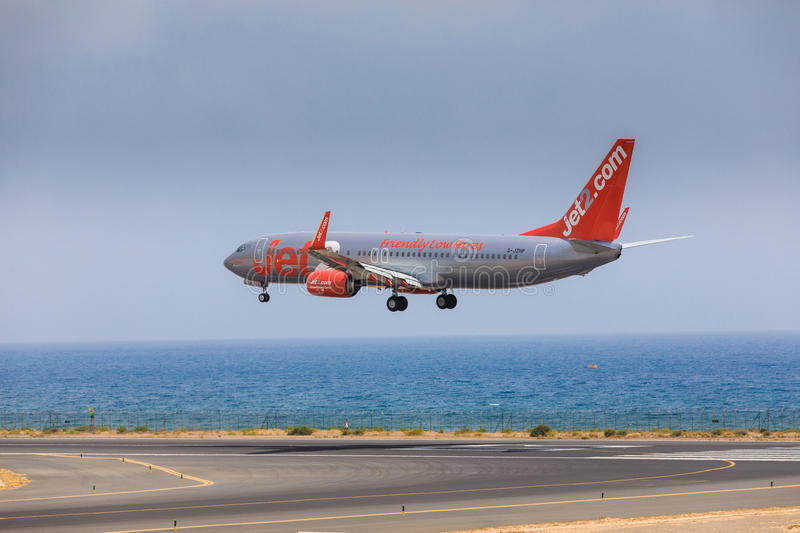 ARECIFE, SPAIN - APRIL, 16 2017: Boeing 737-800 of Jet2 with the. Registration G-JZHG landing at Lanzarote Airport royalty free stock photography