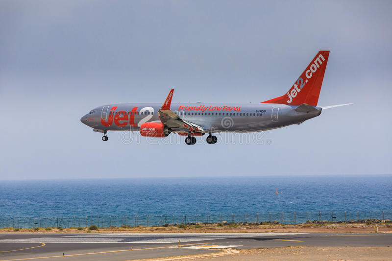 ARECIFE, SPAIN - APRIL, 16 2017: Boeing 737-800 of Jet2 with the. Registration G-JZHG landing at Lanzarote Airport royalty free stock photo