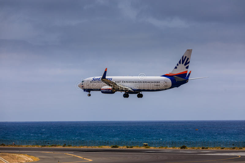 ARECIFE, SPAIN - APRIL, 15 2017: Boeing 737 - 800 of SunExpress. With the registration D-ASXR landing at Lanzarote Airport stock image