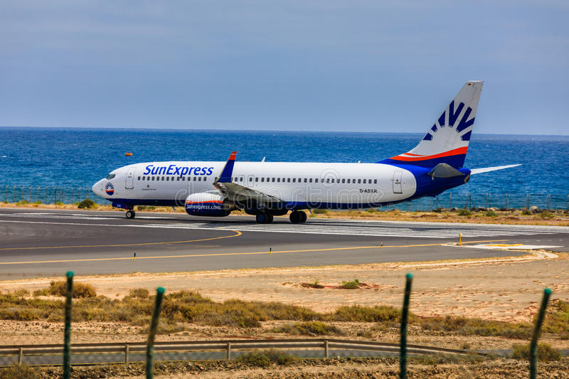 ARECIFE, SPAIN - APRIL, 15 2017: Boeing 737 - 800 of SunExpress. With the registration D-ASXR ready to take off at Lanzarote Airport royalty free stock images