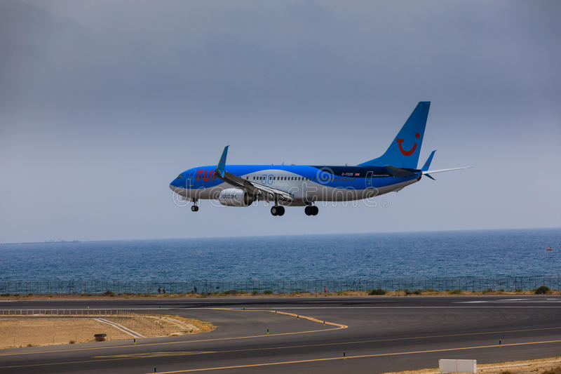 ARECIFE, SPAIN - APRIL, 16 2017: Boeing 737-800 of TUI with the. Registration G-FDZB landing at Lanzarote Airport stock photography