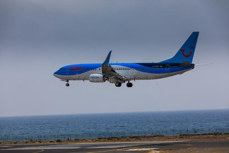 ARECIFE, SPAIN - APRIL, 16 2017: Boeing 737-800 of TUI with the. Registration G-FDZB landing at Lanzarote Airport stock photo