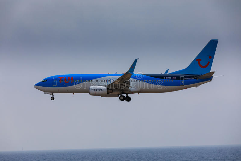 ARECIFE, SPAIN - APRIL, 16 2017: Boeing 737-800 of TUI with the. Registration G-FDZB landing at Lanzarote Airport stock photos