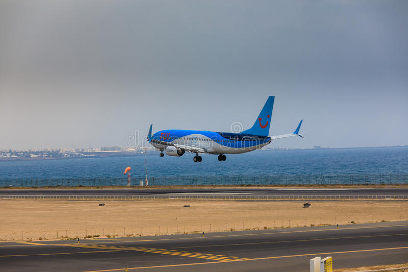 ARECIFE, SPAIN - APRIL, 16 2017: Boeing 737-800 of TUI with the. Registration G-FDZB landing at Lanzarote Airport royalty free stock photos