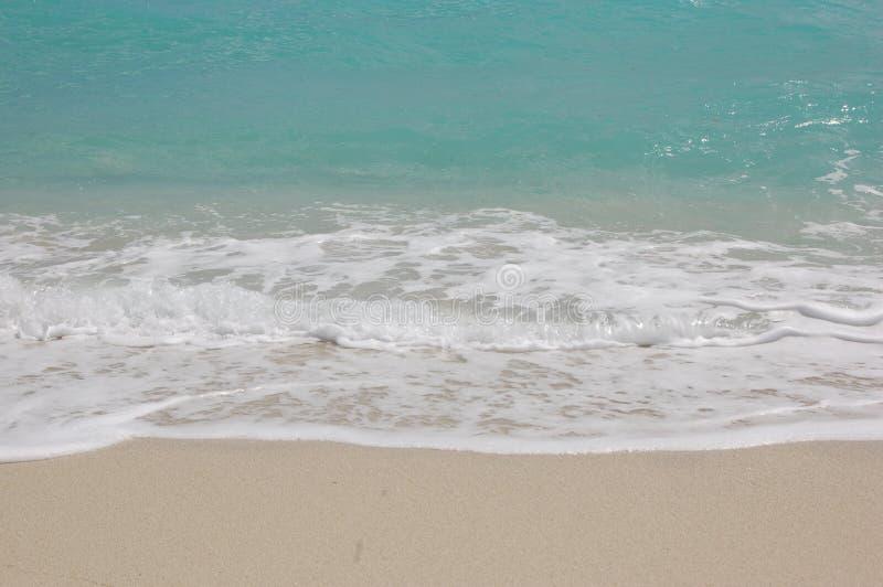 Areia e água fotos de stock