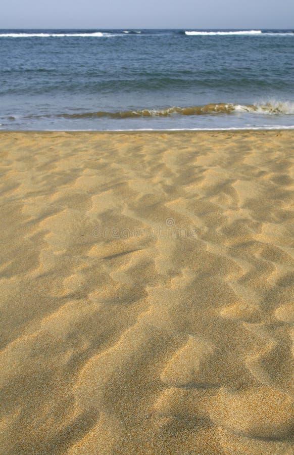 Areia e mar fotografia de stock royalty free