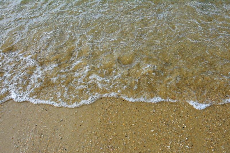 Areia e mar fotos de stock