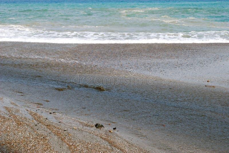 Areia e oceano imagens de stock