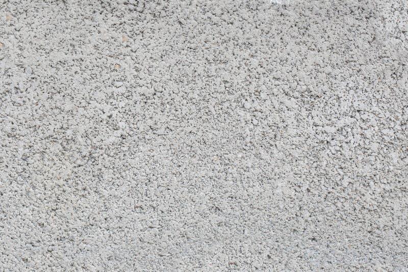 Areia e seixos na parede, texturas do fundo fotografia de stock royalty free