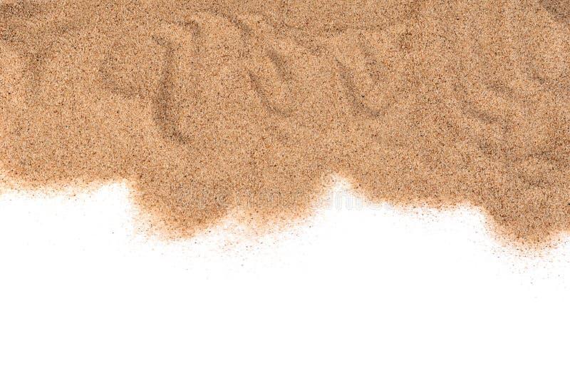 A areia isolada no fundo branco imagens de stock