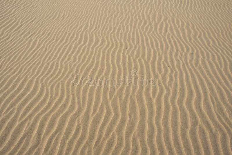 Areia Textured do mar de cima de foto de stock