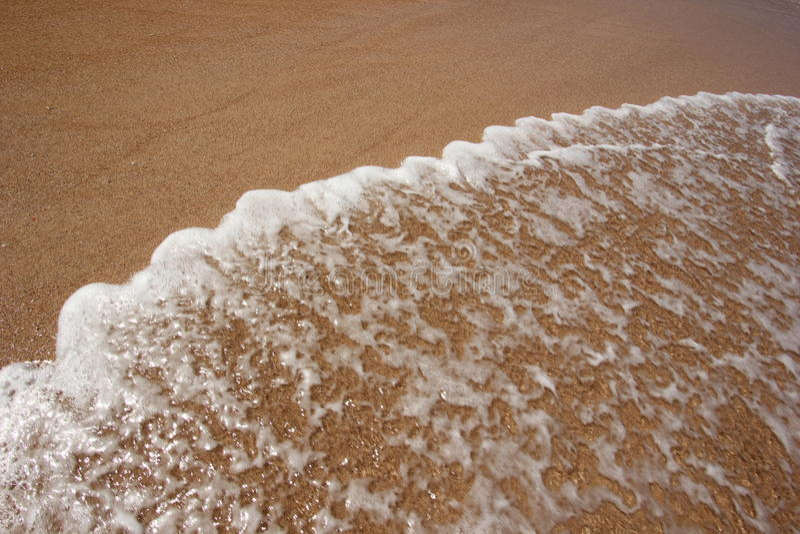 Arena de la playa y agua de mar fotografía de archivo libre de regalías