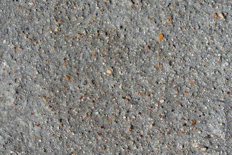 Arena volcánica gris, pequeña superficie de piedra colorida Fondo natural o textura fotografía de archivo libre de regalías