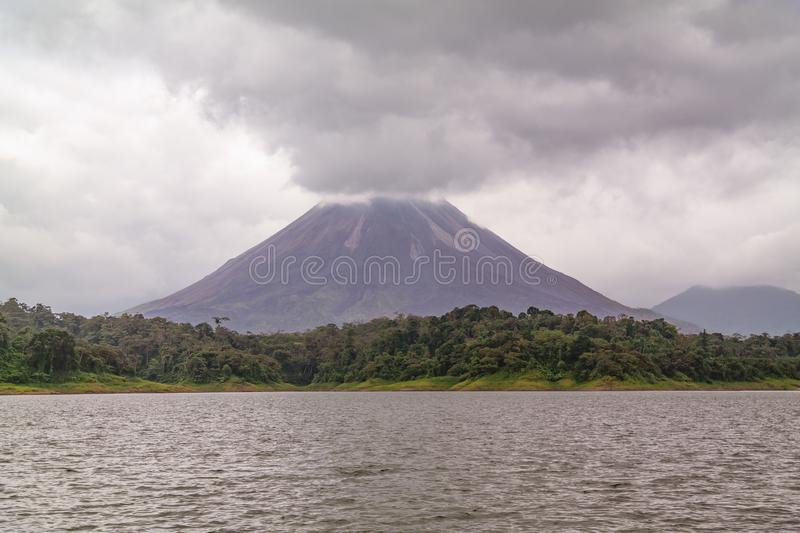 Arenal volcano viewed from the perspective of the lake stock images
