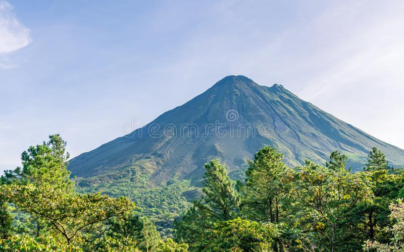 Arenal Volcano, which has an almost perfect cone shape, is one of the biggest tourist attraction in Alajuela, Costa Rica. Nature, travel, central, america royalty free stock photos