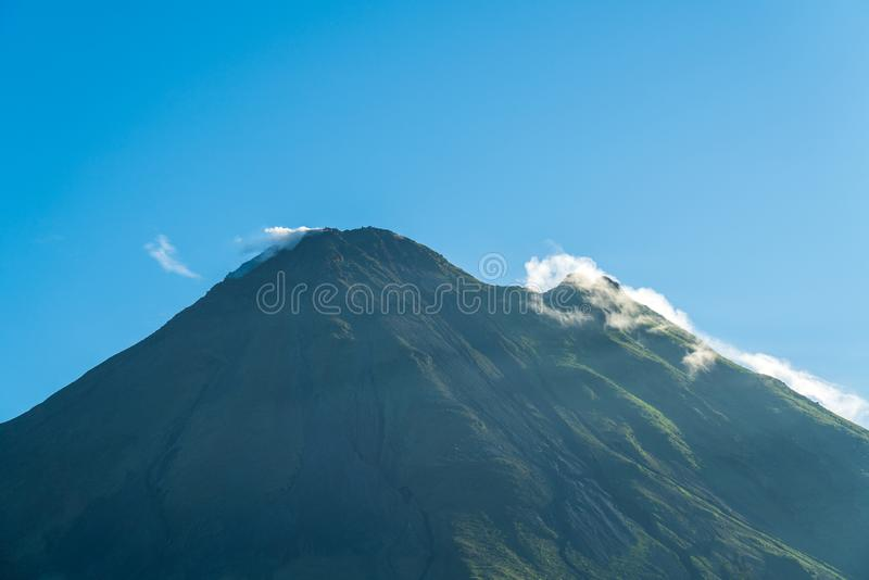 Arenal Volcano, which has an almost perfect cone shape, is one of the biggest tourist attraction in Alajuela, Costa Rica. Nature, travel, central, america royalty free stock images