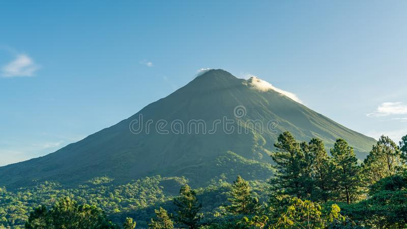 Arenal Volcano, which has an almost perfect cone shape, is one of the biggest tourist attraction in Alajuela, Costa Rica. Nature, travel, central, america stock photography