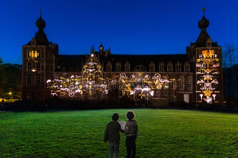 Arenberg Festival Leuven. Children watching an enchanting lights projection on the facade of the arenberg castle by video artist Nele Fack