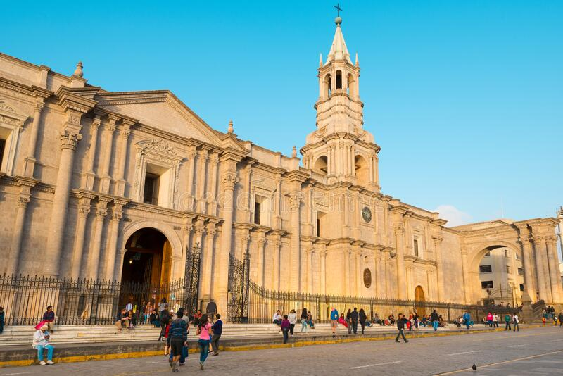 Pople outside the cathedral Catedral basilica de Arequipa at the main square royalty free stock photos