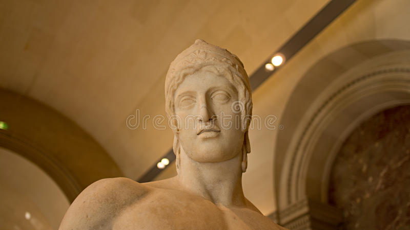 Ares Borghese sculpture head photo, Louvre Museum, France. A close up photo of the head and upper torso of the sculpture Ares Borghese. This is a Roman marble stock photo