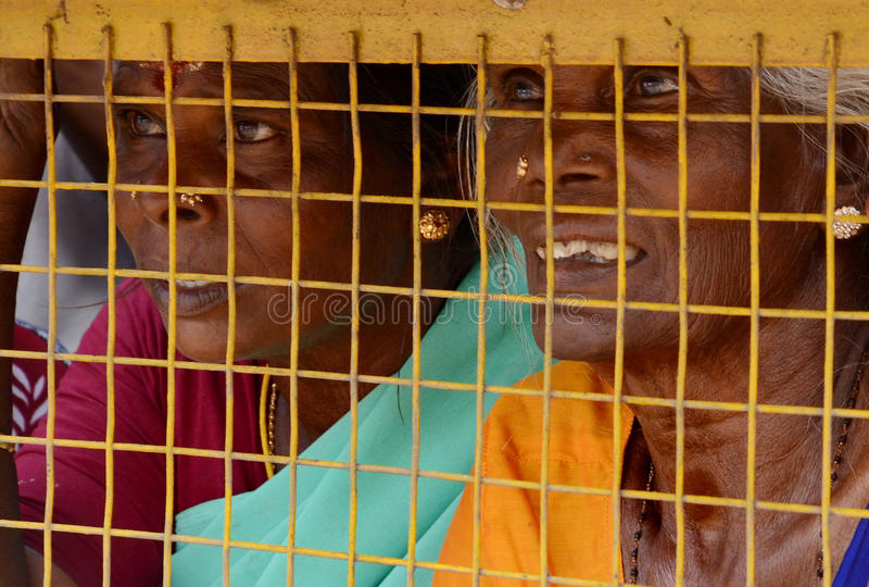 ARESSTED WOMEN PROTESTER. A portrait of a old womenlooking through fence on a sad being arrested for trying to protest for thier street problem at trichy ,Tamil royalty free stock image