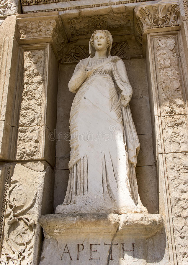 Arete statue, Celsus Library, Ephesus. The statue Arete representing virtue stands in a niche in the front of the Celsus Library. It is one of 4 statues, each royalty free stock images