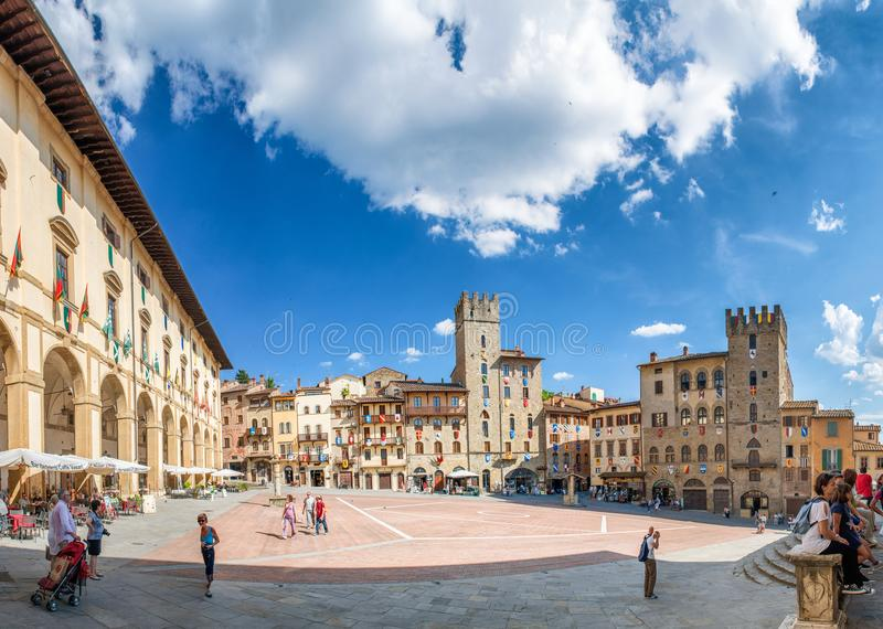 AREZZO, ITALY - JUNE 2015: Piazza Grande with tourists. Arezzo i. S a famous destination in Tuscany royalty free stock photography
