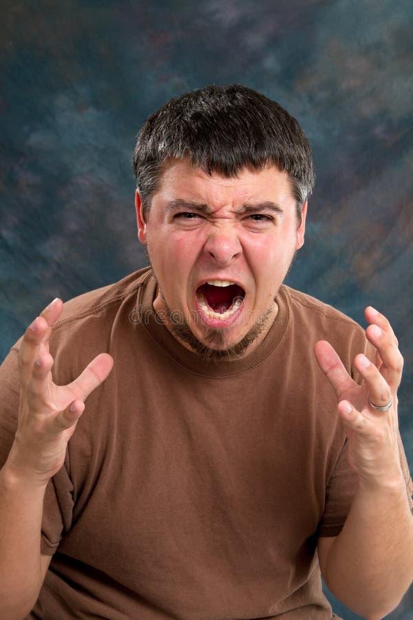 arg man fotografering för bildbyråer