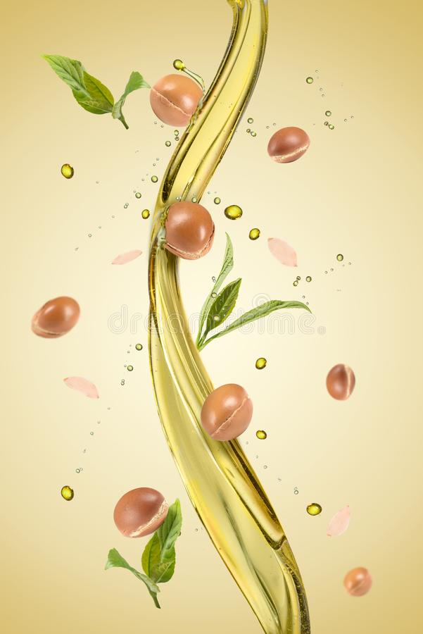 Spash of oil with argan stock photography