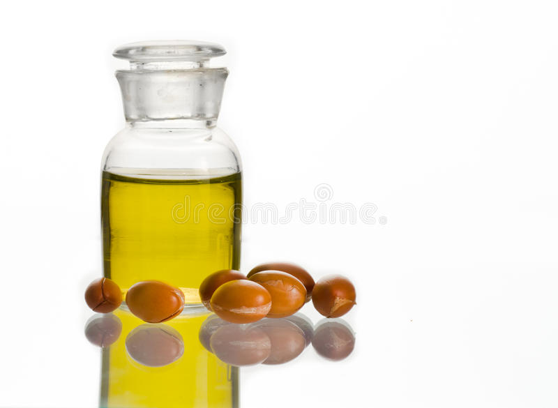 Argan oil with fruits stock photography
