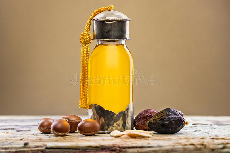 Argan oil and fruits stock photography