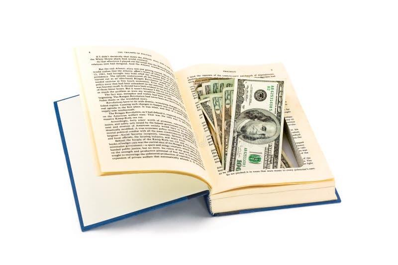 argent caché par livre vieux photo stock