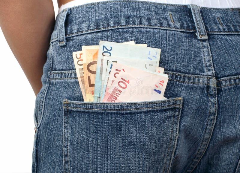 Argent dans une poche de jeans photographie stock