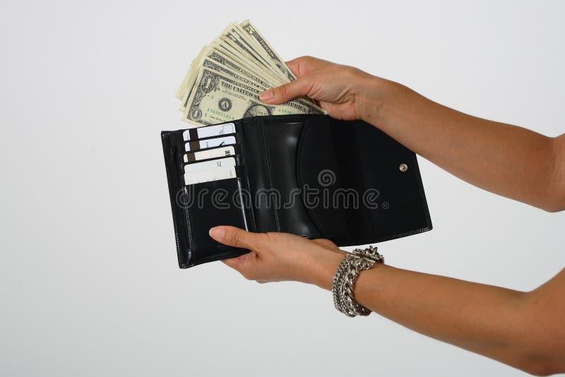 Argent de dépense photos stock