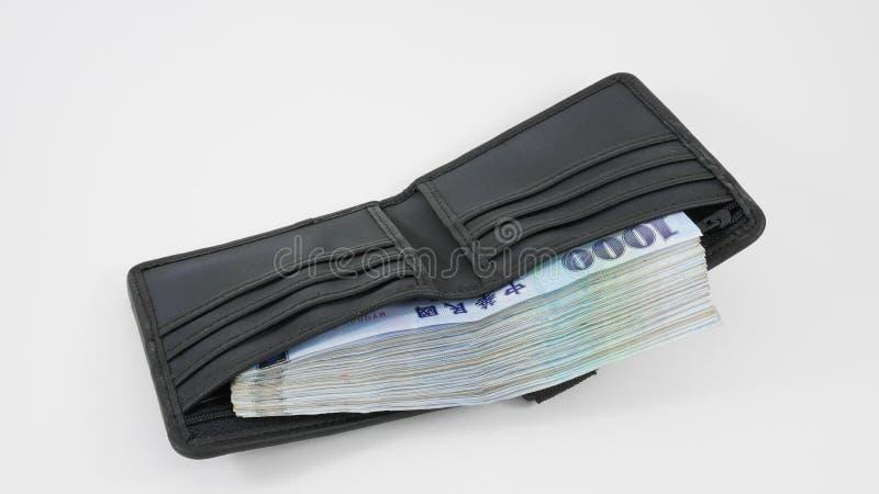 Argent du dollar de nouveau Taïwan dans le portefeuille (1) photos libres de droits