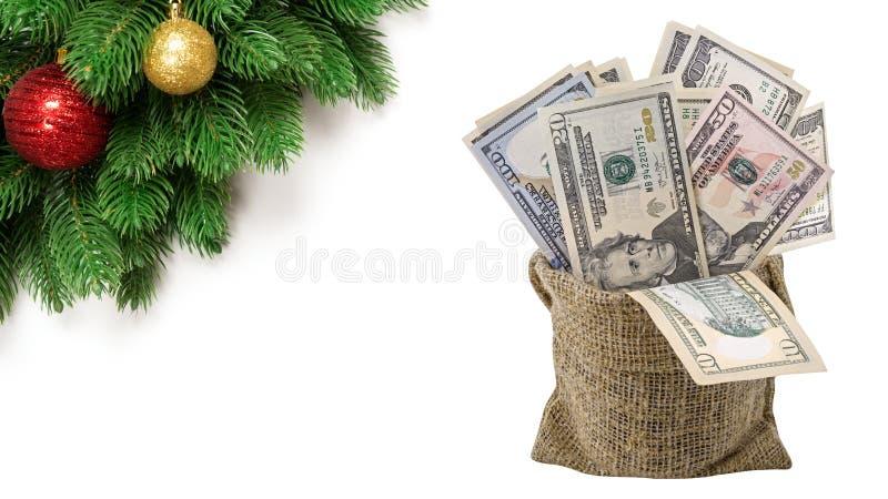 Argent liquide de pile argent de dollars US dans le sac sur le fond d'isolement par Noël images stock