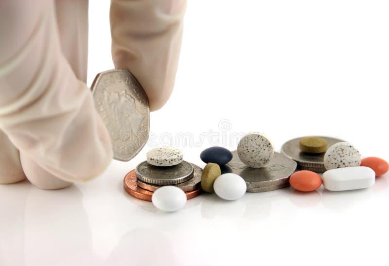 Argent ou médecine ? ? photographie stock libre de droits