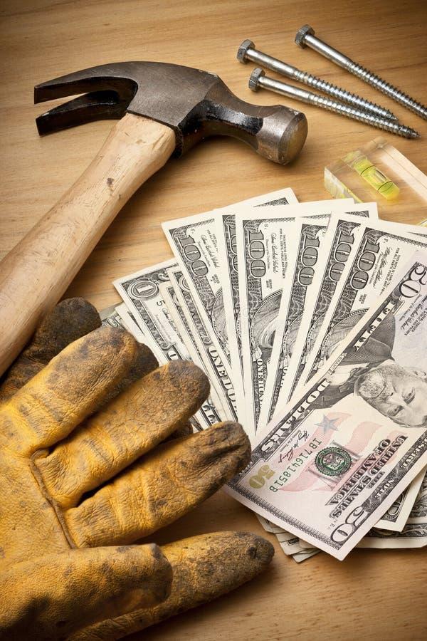 Argent pour la rénovation de construction images stock